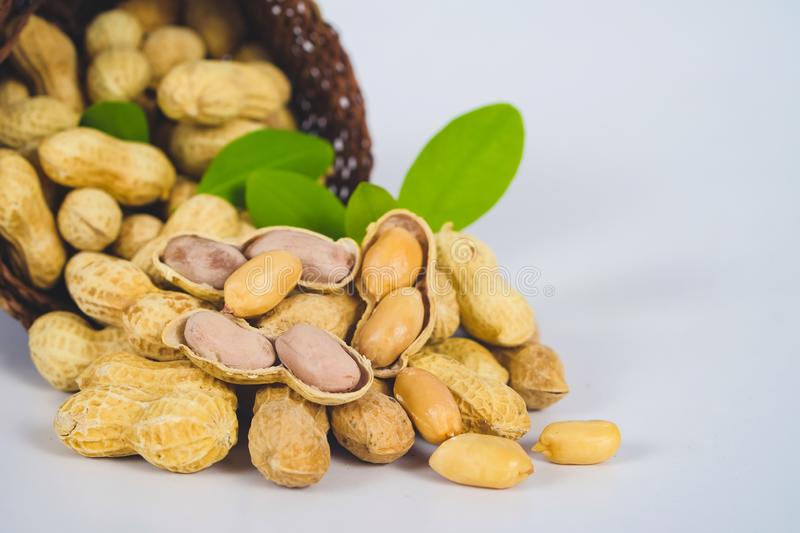 Peanut spill out of basket royalty free stock photo