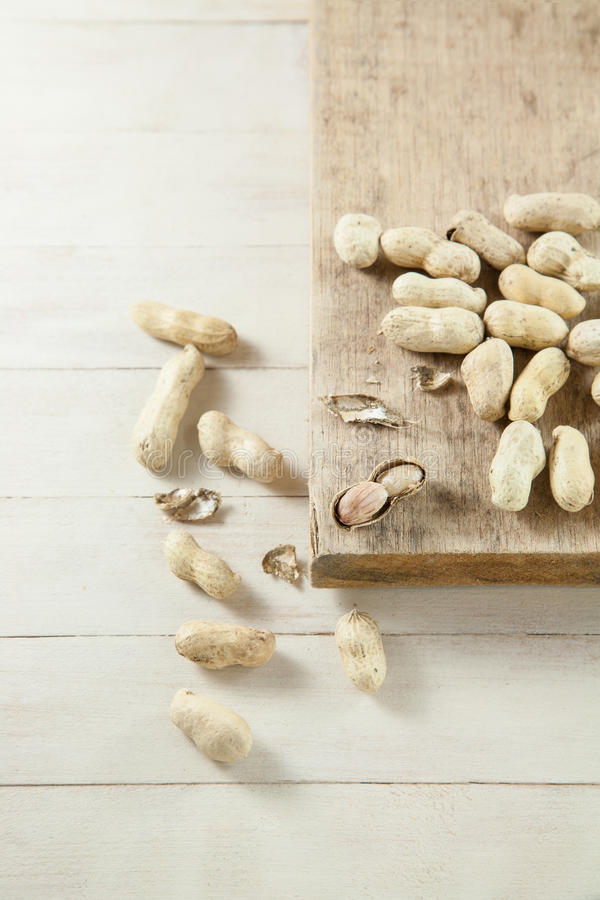 Peanut on the wood table. royalty free stock images