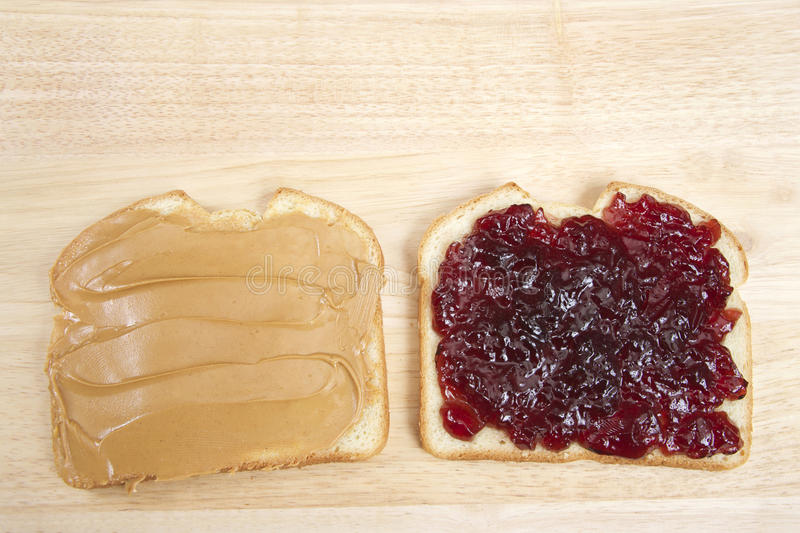 Peanutbutter and Jelly Sandwich on white bread open face stock photos