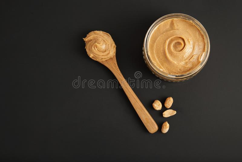 Peanuts and Fresh Peanut Butter Isoalted Black Background Protein Super Food Snack. Peanuts and Fresh Peanut Butter Isoalted Black Background Protein Super Food royalty free stock image