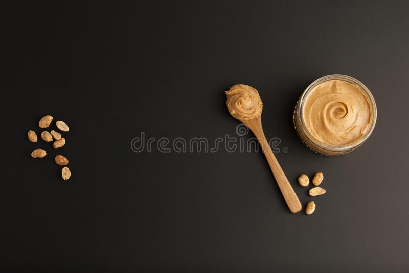 Peanuts and Fresh Peanut Butter Isoalted Black Background Protein Super Food Snack. Peanuts and Fresh Peanut Butter Isoalted Black Background Protein Super Food royalty free stock photo