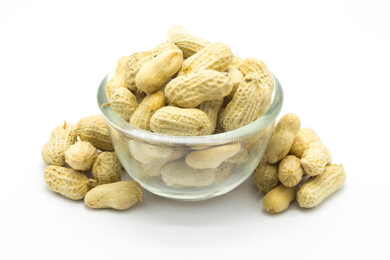 Peanuts on glass bowl stock photos