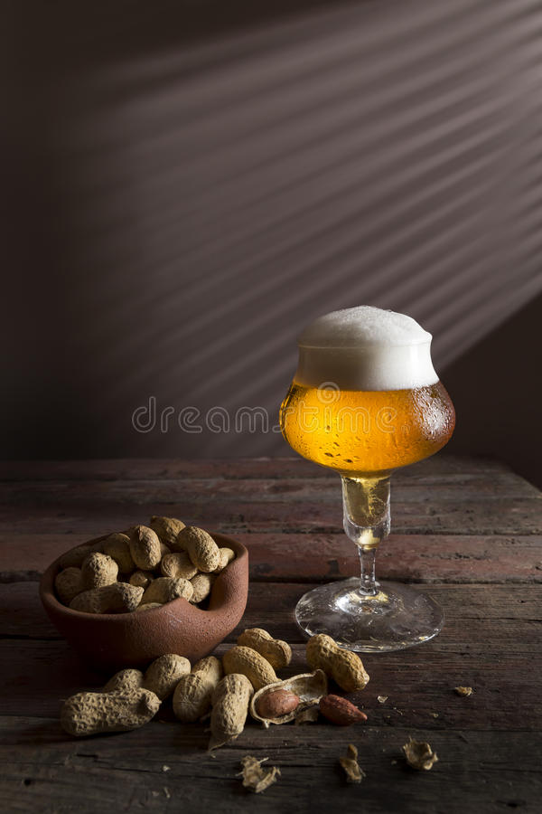 Peanuts and light beer royalty free stock image