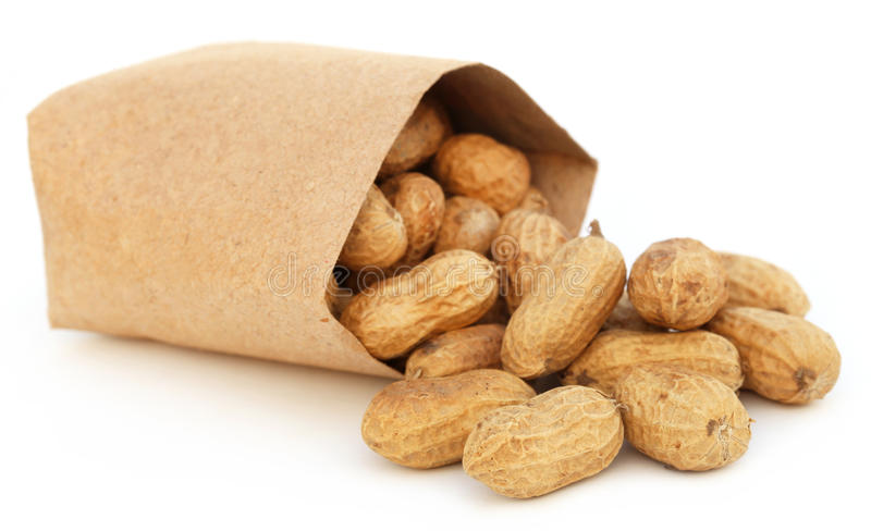 Peanuts in a packet. Over white background royalty free stock image