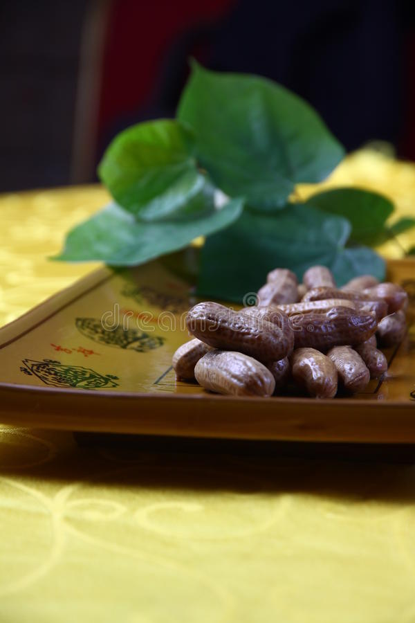 Peanuts on a plate stock photo
