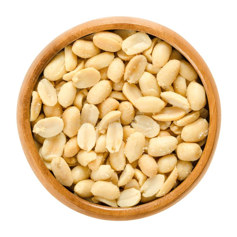 Peanuts, roasted and salted, in wooden bowl, over white royalty free stock photo
