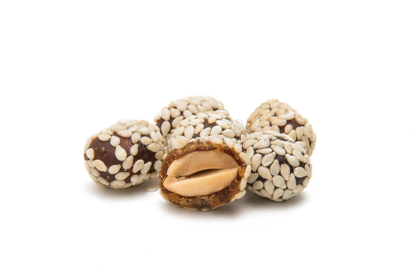 Peanuts in sesame seeds royalty free stock photography