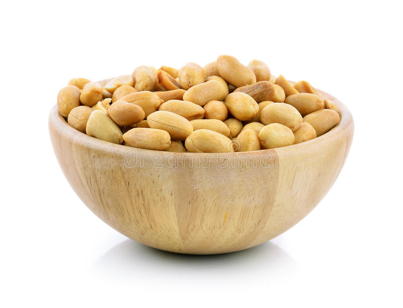 Peanuts in a wood bowl on white royalty free stock photography