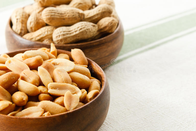 Peanuts in Wood Bowls stock image