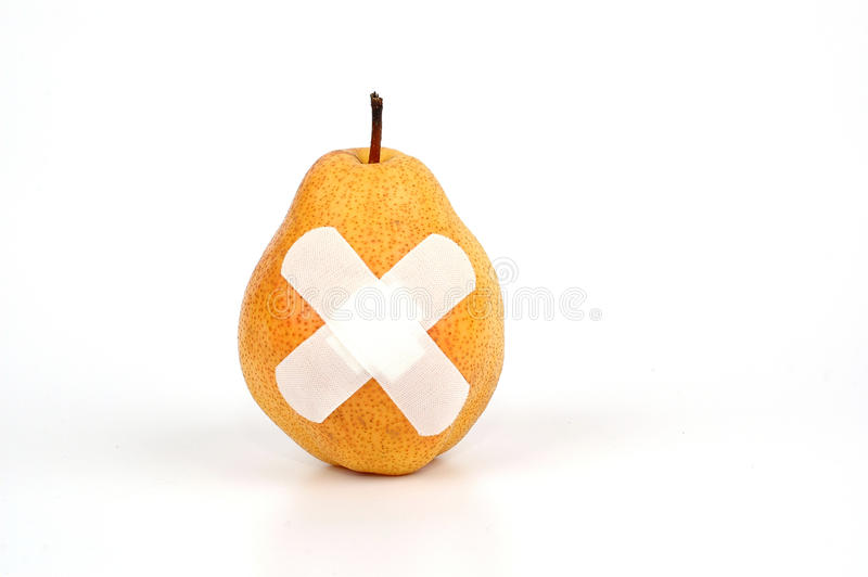 Pear with Adhesive first-aid bandages. Food control concept , Unhealthy Fruit royalty free stock image