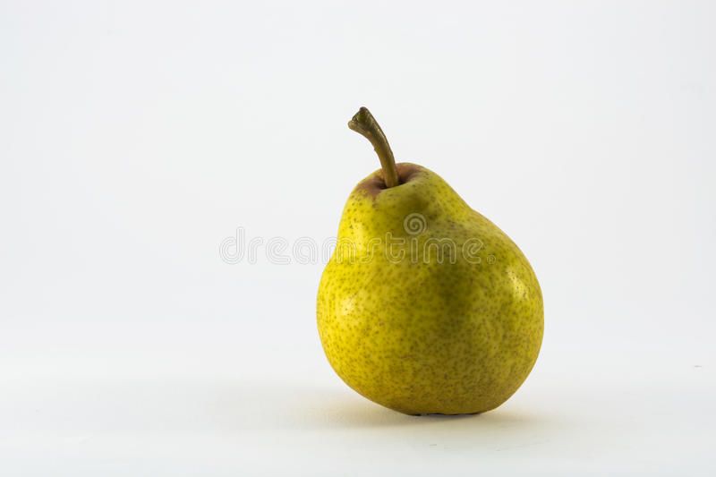 Pear. A beautiful green colored fantastic pear freshly picked from the tree biology royalty free stock photos