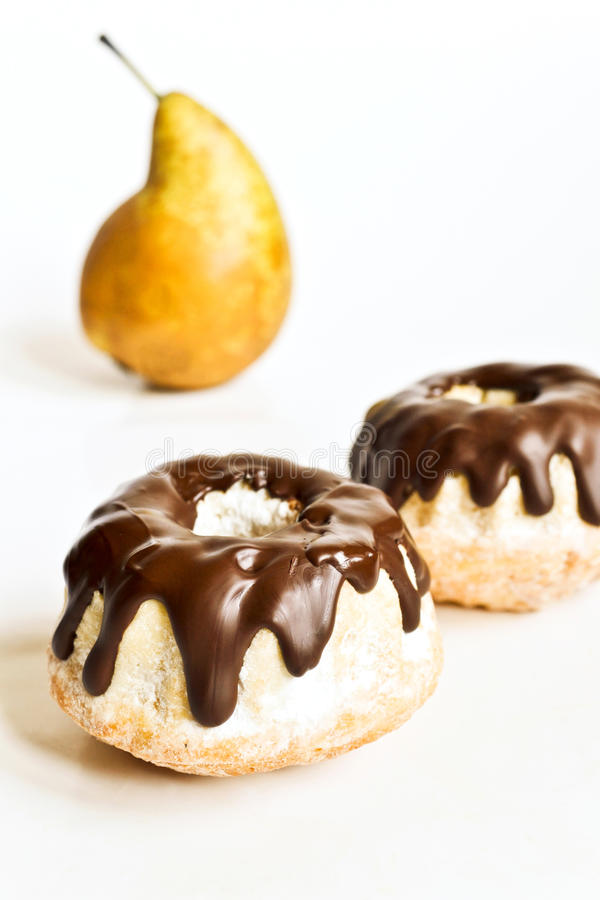 Pear cakes with chocolate stock image