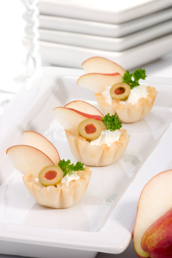 Pear and creamcheese canapes royalty free stock photos