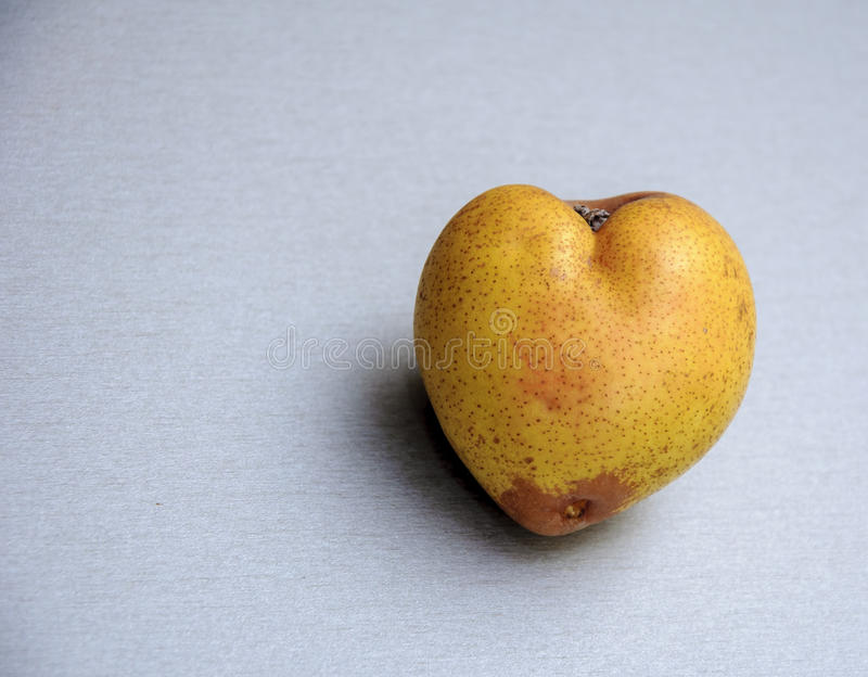 Pear in the form of heart stock photography