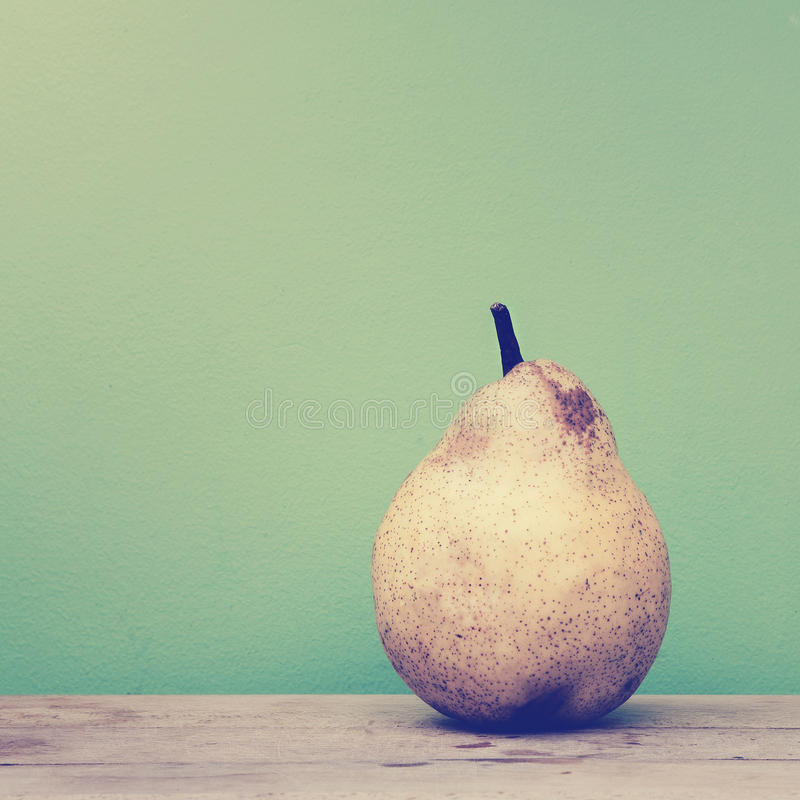 Pear on green background royalty free stock photos