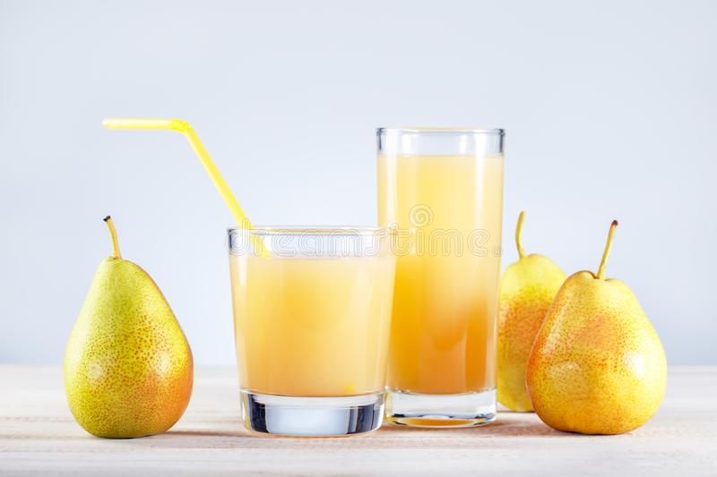 Healthy food and drink Pear Juice with fresh fruits on wooden table. royalty free stock photo