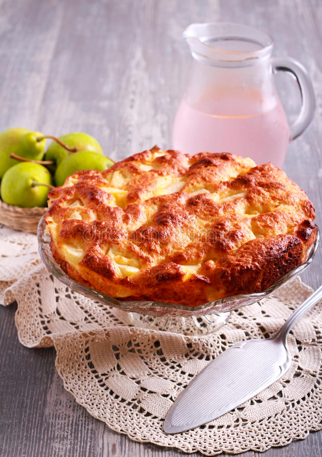 Pear, maple and ricotta cake. On plate royalty free stock image