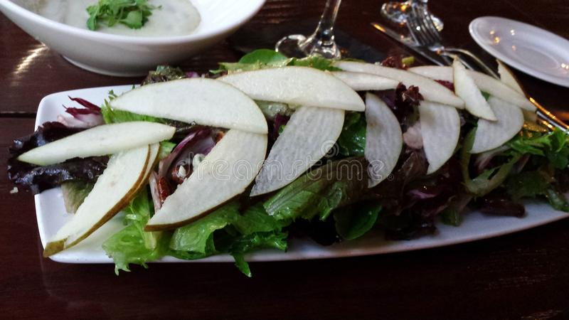Download Pear salad with lettuce stock photo. Image of pear, greens - 54772220