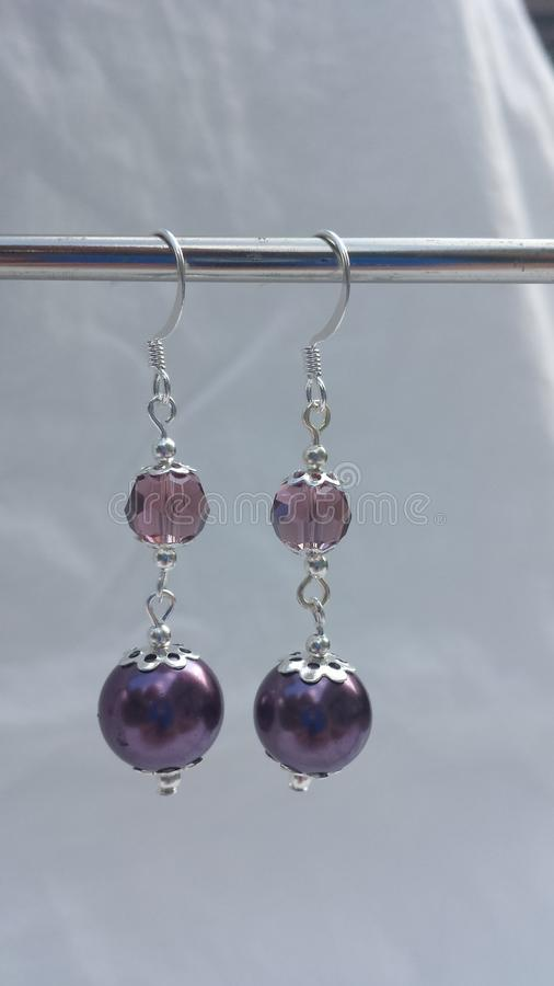Pearl and crystal drop style earrings with silver plated spacers and ear wire. These beautiful earrings will accent any outfit. Hand made and designed by Amanda stock images