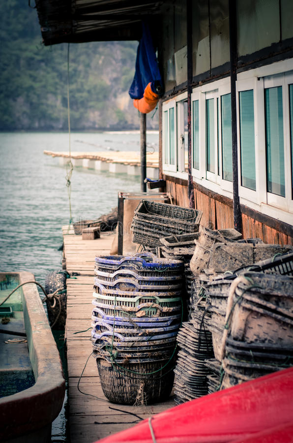 Pearl farm. Stacks of baskets on a house on a pearl farm royalty free stock image