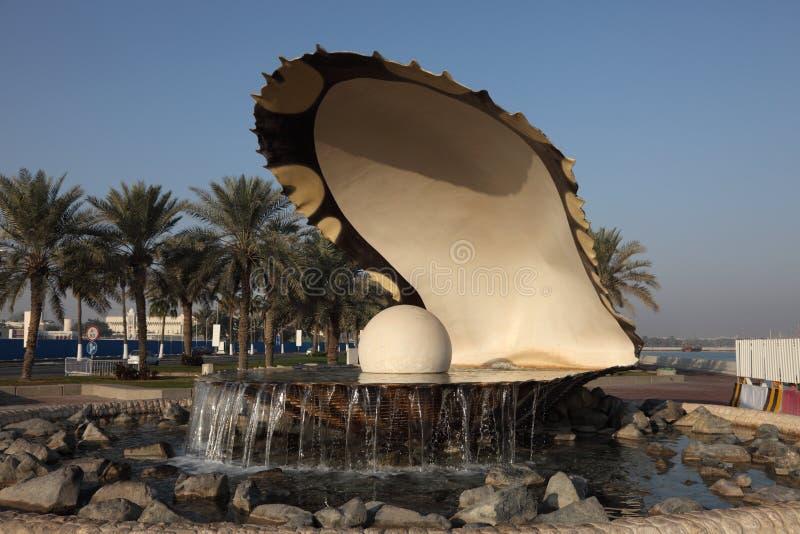 Pearl Fountain in Doha, Qatar. Oyster Pearl Fountain on the Corniche of Doha, Qatar royalty free stock image