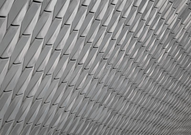 Gray abstract background with perspective. The scaly flaky of the pattern. stock photo