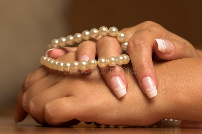 Download Pearl and hand stock photo. Image of nail, women, palls - 26838048
