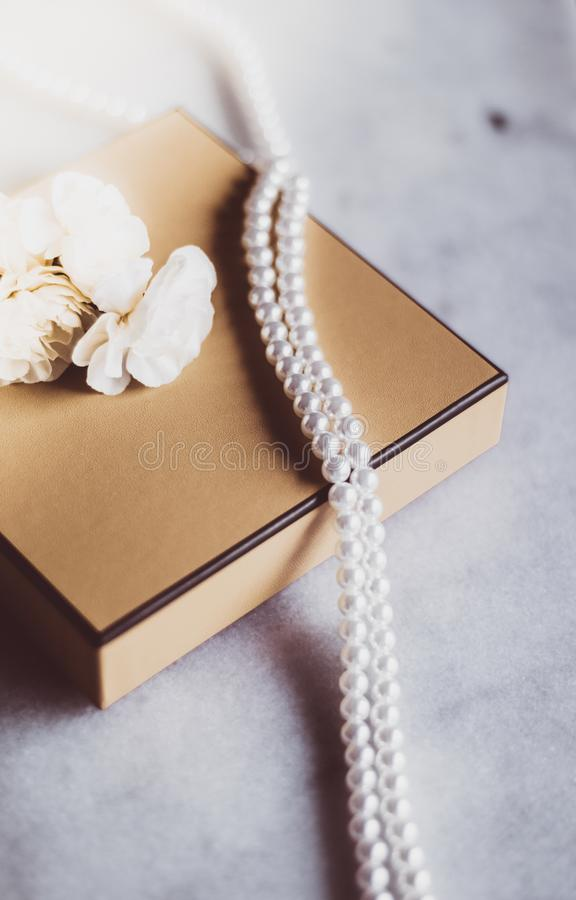 Pearl jewellery in a  golden gift box stock photos