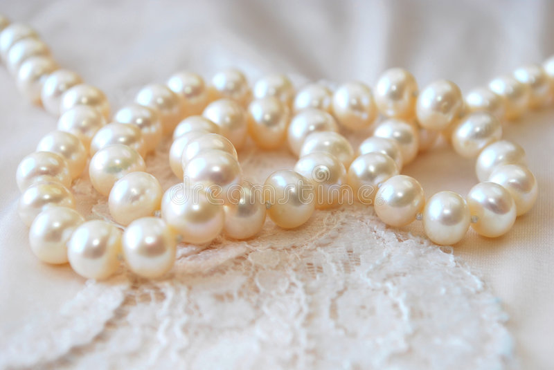 Pearl Necklace. White pearl necklace with lace stock photography