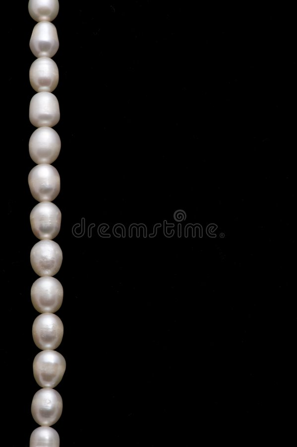 Pearl Necklace. A valuable pearl necelace is in dark background stock image
