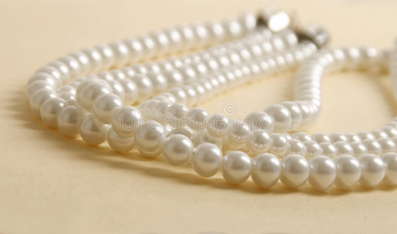 Pearl necklace. Bijouterie jewelry artificial pearl necklace royalty free stock photo