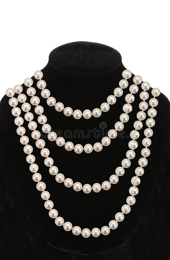 Pearl necklace on black mannequin isolated on white stock photo