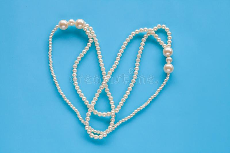 Pearl Necklace on color. White Pearl Necklace on color background stock photo