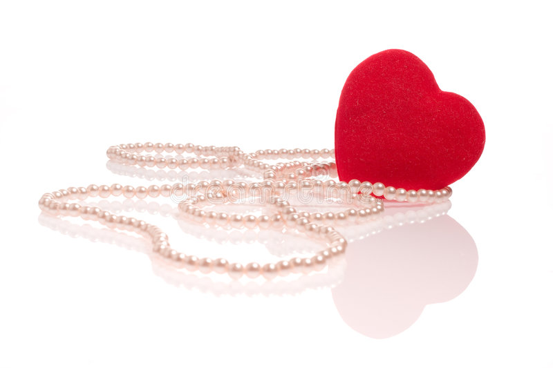 Pearl necklace and a heart stock photos