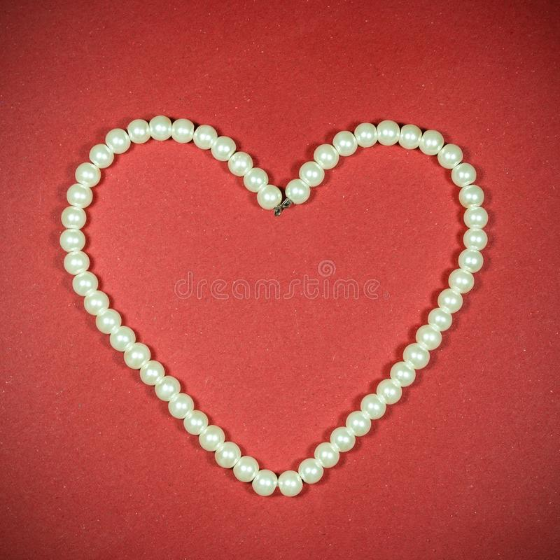 Pearl necklace in love shape stock images