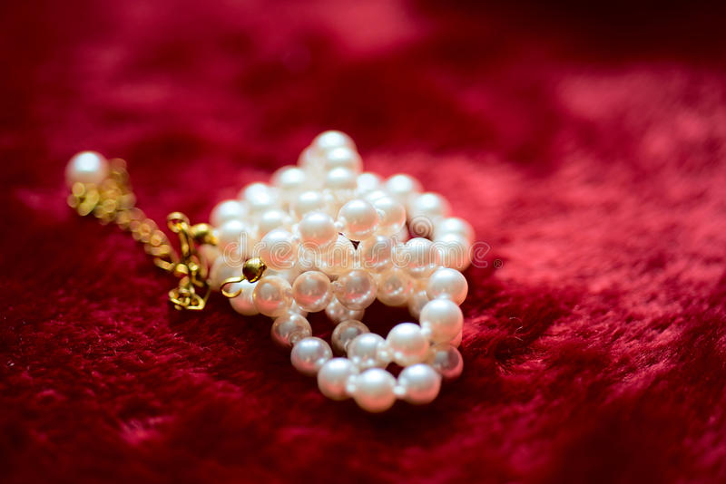 Download Pearl Necklace On Plush Red Material Stock Image - Image: 30629825