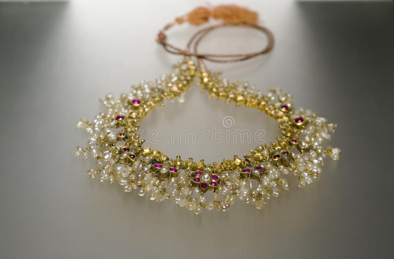 Pearl necklace. Real pearl necklace made from sea pearls, diamonds and gold royalty free stock photos