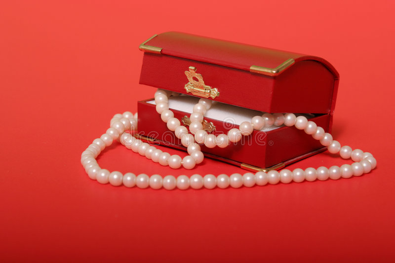 Pearl necklace in red gift box stock photos