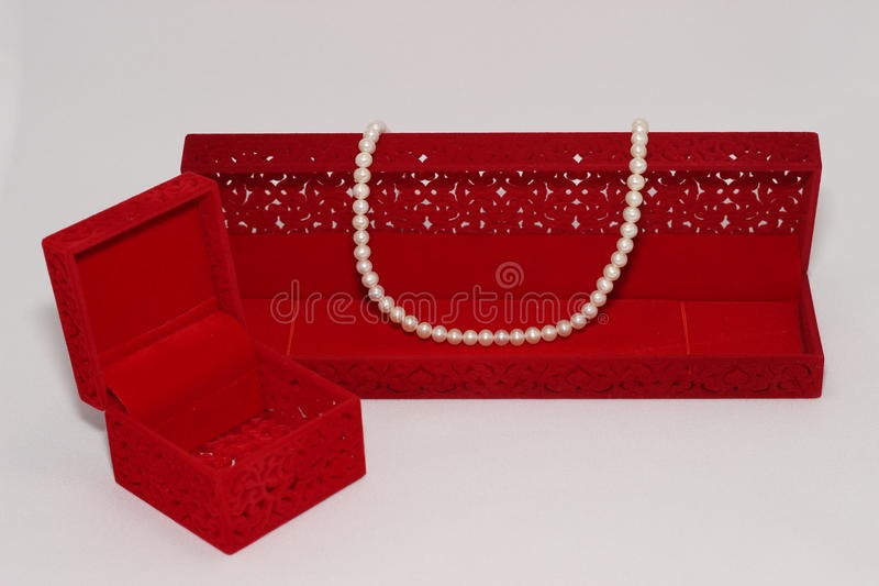 Pearl necklace and red gift box royalty free stock photography