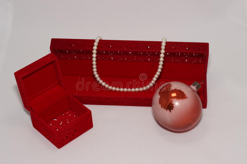 Pearl necklace and red gift box stock photos