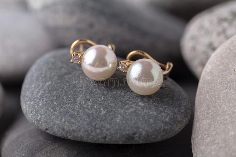 Pearl necklaces and earrings stock images