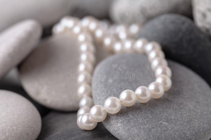 Pearl necklaces and earrings royalty free stock image