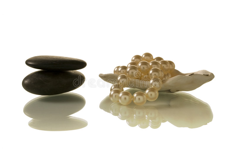 Pearl and pebble royalty free stock images