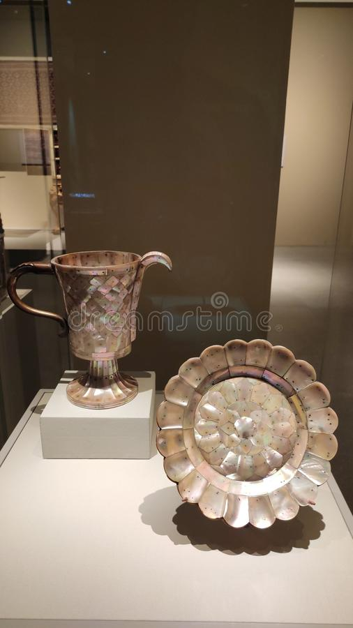 Pearl plauques mounted by silver pin Pitcher and  dish, Singapore. The Pitcher and  dish is composed of mother-of-pearl plaques mounted by silver pins. The stock images