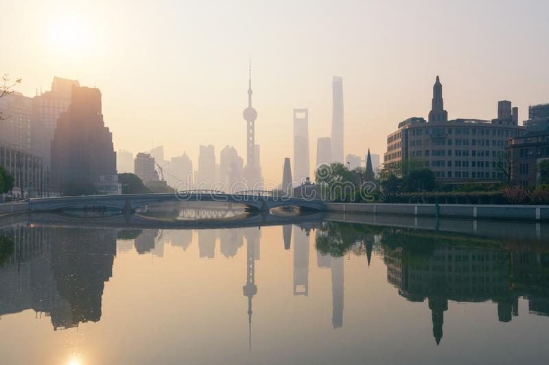 The Pearl in Shanghai Downtown skyline by Huangpu River with fog, China. Financial district and business centers in smart city in stock images