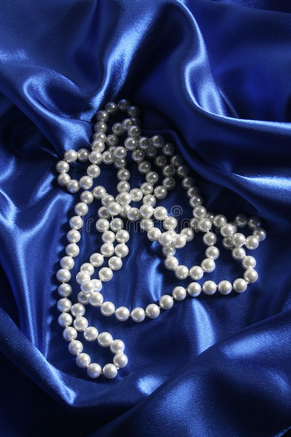 Pearls. A necklace on a silk fabric stock photos