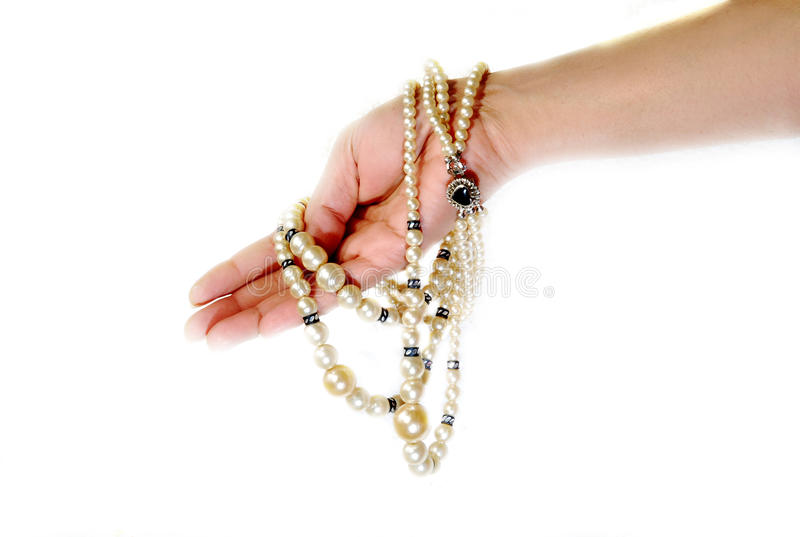 Pearls in hand royalty free stock image
