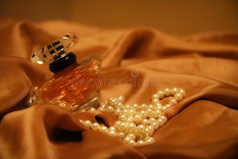 Pearls and perfume royalty free stock images
