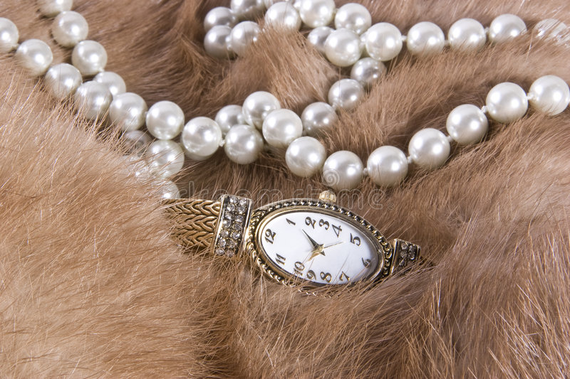 Pearls and Watch on Mink stock images