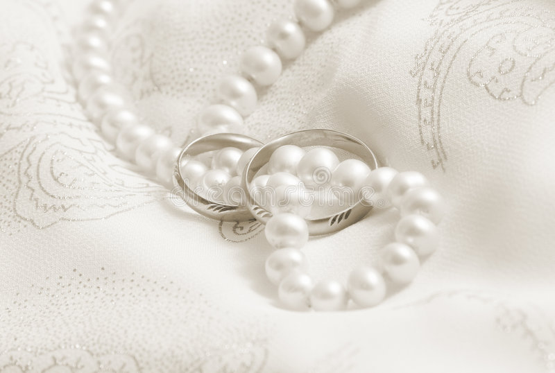 Pearls and wedding bangs. Toning in sepia. stock image